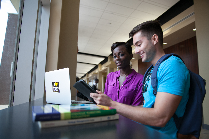 2 students with a laptop, Photos courtesy of University of Central Florida.